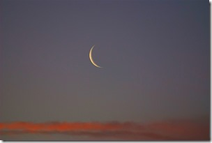 1200px-New_Moon_at_sunset_pd