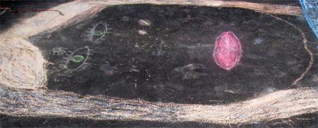 Photo of Chalk Drawings on Driveway